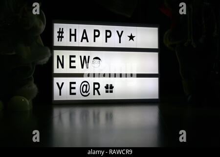 New year light note. New years congratulations on light board. Happy New Year note. - Stock Photo