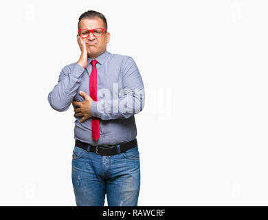 Middle age arab man wearing fashion red glasses over isolated background thinking looking tired and bored with depression problems with crossed arms. - Stock Photo