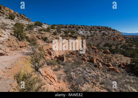 Trail along a cliff at the Tsankawi Prehistoric Sites in Bandelier National Monument near Los Alamos, New Mexico - Stock Photo