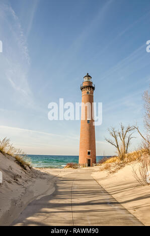 Standing on this spot since 1874, this lighthouse was originally called Petite Pointe Au Sable Lighthouse (little point of sand). - Stock Photo