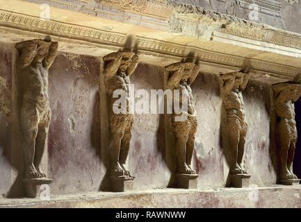 Italy. Pompeii. The Forum thermal baths. Public baths, edificated immediately after the founding of the colony (after 80 BC). They were subdivided into menÕs and womenÕs section. Tepidarium (warm room). Detail of Telamons. Inside. Campania. - Stock Photo