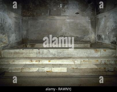 Italy. Pompeii. The Forum thermal baths. Public baths, edificated immediately after the founding of the colony (after 80 BC). They were subdivided into menÕs and womenÕs section. Room of the 'calidarium' with its hot water bath. Marble pool. Campania. - Stock Photo