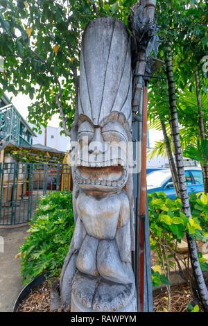 Honolulu, Hawaii - Dec 25, 2018 : Ancient Polynesian style tiki wooden carvings in Waikiki beach - Stock Photo