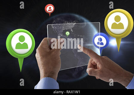 Composite image of cropped hand on businessman using glass interface - Stock Photo