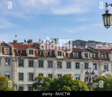 Lisbon - Portugal, overview on the Rossio, castle Sao Jorge in second line - Stock Photo