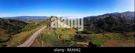Panorama drone shot aerial view landscape of mountain and nature against blue sky - Stock Photo
