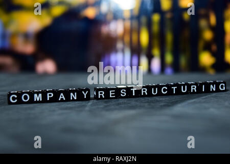 Company restructuring on wooden blocks. Business and finance concept. Cross processed image with bokeh background - Stock Photo