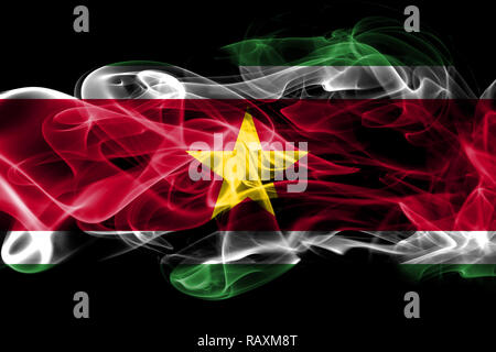 National flag of Suriname made from colored smoke isolated on black background - Stock Photo