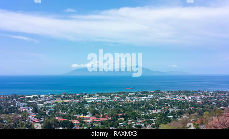 Looking across Dili and the Banda Sea toward Atauro Island. - Stock Photo