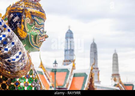Guardian statues at the base of the Golden Chedi of Wat Phra Kaew, Grand Palace, Bangkok - Stock Photo