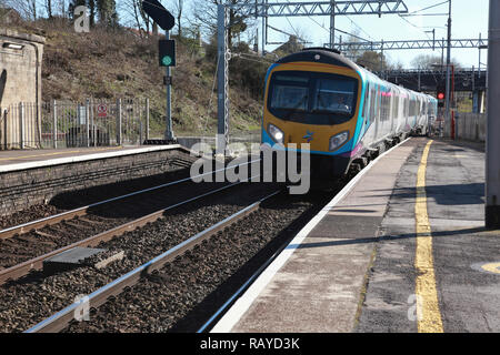 A TransPennine Express train approaching Platform 2 at Oxenholme station in the Lake District, Cumbria, northern England - Stock Photo