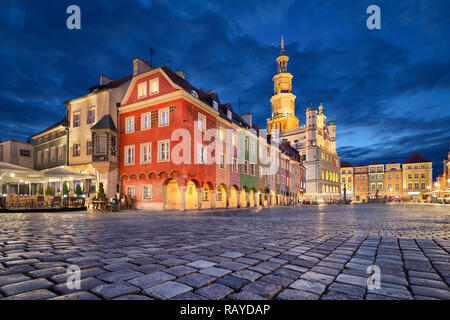 Stary Rynek square with small colorful houses and old Town Hall at dusk in Poznan, Poland - Stock Photo