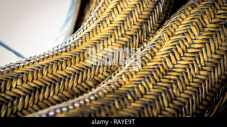 Abstract image of Cane Furniture weave up close, Weave pattern on patio furniture, pattern texture for design background - Stock Photo