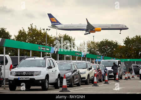 car hire company Alamo, Enterprise, National car rental village at Manchester Airport - Stock Photo