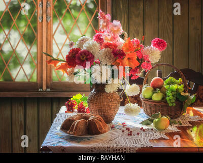 Still life with mixed bouquet of autumn flowers - Stock Photo
