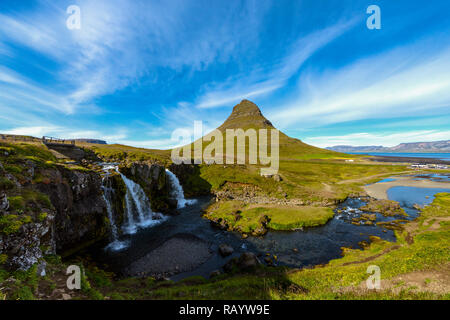 Kirkjufell (Icelandic: Church mountain) is a 463m high mountain on the north coast of Iceland's Snæfellsnes peninsula, near the town of Grundarfjörður - Stock Photo