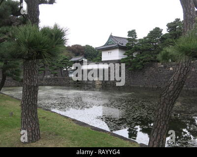 One of the guard towers atop the stone walls of the moat; Imperial Palace East Gardens, Tokyo, Japan - Stock Photo