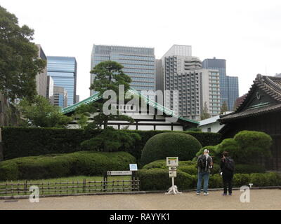 View of the Tokyo Imperial Palace East Gardens: traditional buildings contrast with modern office bocks at this public garden in the centre of Tokyo - Stock Photo
