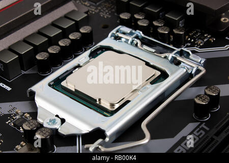 Prague, CZECH REPUBLIC - DECEMBER 19, 2018: Focus at i5 CPU, computer processor installed on motherboard socket 1151 - Stock Photo