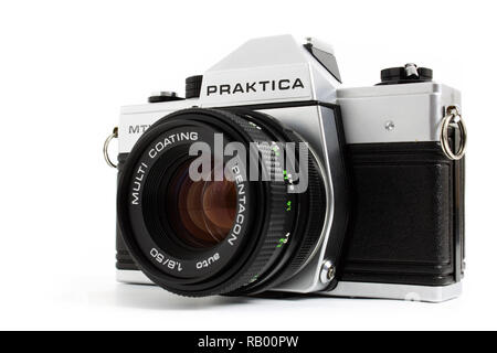 Prague, CZECH REPUBLIC - DECEMBER 24, 2018: Old SLR camera Praktica MTL5 for 35mm film made by German company Pentacon between 1983 and 1985 laid on w - Stock Photo