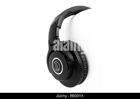 Prague, CZECH REPUBLIC - DECEMBER 30, 2018: Popular closed professional monitor headphones Audio Technica ATH-M40x Corporation laid on white backgroun - Stock Photo