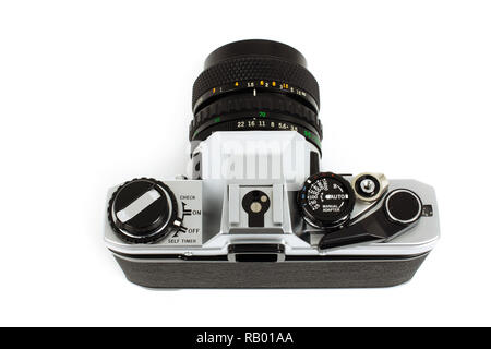 Old SLR camera for 35mm film strip, top angle view as photographer - Stock Photo