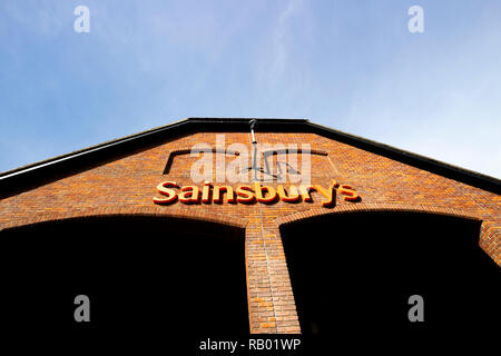Sainsburys supermarket sign over entrance, founded in 1869 by John James Sainsbury with a shop in Drury Lane London - Stock Photo