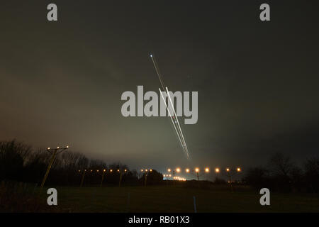 Aircraft on final approach landing at Glasgow International Airport, Renfrew, Renfrewshire, UK - 4th January 2019. - Stock Photo