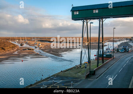 The quay at Wells-next-the-Sea behind the salt marshes on the north Norfolk coast. - Stock Photo