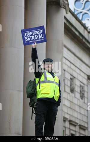 Manchester, UK. 5th January 2019. A pro Brexit protester wearing a Yellow Vest holds up a placard which reads 'Stop Brexit Betrayal', Manchester, UK, 5th january 2019 Credit: Barbara Cook/Alamy Live News - Stock Photo