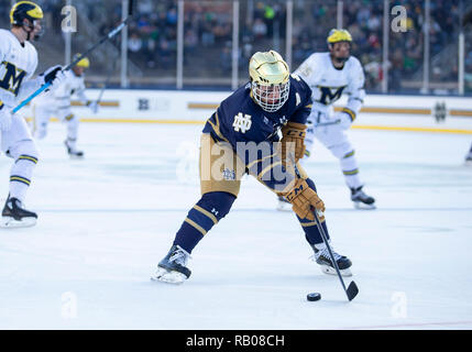 South Bend, Indiana, USA. 05th Jan, 2019. Notre Dame forward Cal Burke (11) skates with the puck during NCAA Hockey game action between the Michigan Wolverines and the Notre Dame Fighting Irish at Compton Family Ice Arena in South Bend, Indiana. John Mersits/CSM/Alamy Live News - Stock Photo