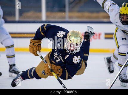 South Bend, Indiana, USA. 05th Jan, 2019. Notre Dame defenseman Bobby Nardella (27) gets tripped up during NCAA Hockey game action between the Michigan Wolverines and the Notre Dame Fighting Irish at Compton Family Ice Arena in South Bend, Indiana. John Mersits/CSM/Alamy Live News - Stock Photo