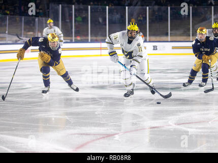 South Bend, Indiana, USA. 05th Jan, 2019. Michigan forward Brendan Warren (11) skates with the puck during NCAA Hockey game action between the Michigan Wolverines and the Notre Dame Fighting Irish at Compton Family Ice Arena in South Bend, Indiana. John Mersits/CSM/Alamy Live News - Stock Photo