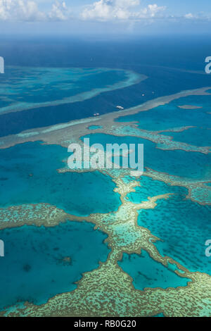 Great Barrier Reef as seen from above from a plane at the coast of the Whitsunday Islands (Queensland, Australia) - Stock Photo