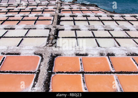 Different colors during the salination evaporation process in the salt fields of Fuencaliente, La Palma Island, Canary Islands, Spain - Stock Photo