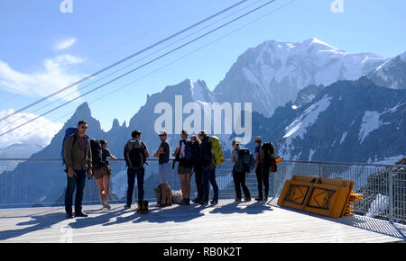 Tourists on the panoramic terrace Skyway Monte Bianco on the Italian side of Mont Blanc. Italy. - Stock Photo