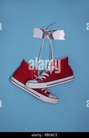Used red sneakers - Stock Photo
