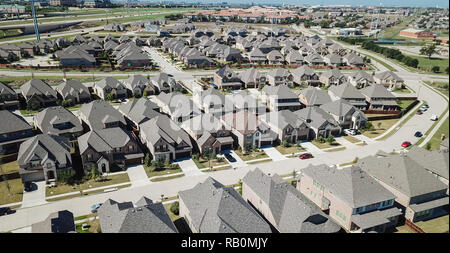Aerial view new residential neighborhood near elevated expresswa - Stock Photo