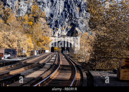 Harpers Ferry, WV, USA - November 3, 2018: The Harpers Ferry railroad tunnel in West Virginia on a bright autumn day. - Stock Photo