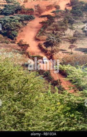 Safari Jeep in the Serengeti - Stock Photo