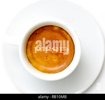 text ptsd on espresso cup of coffee on white background , image - Stock Photo
