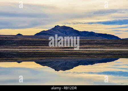 Reflection of Antelope Island in the Great Salt Lake. - Stock Photo