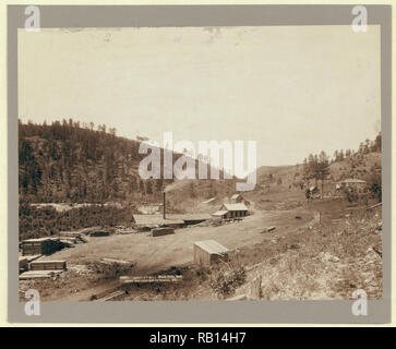 John C. H. Grabill,, photographer, Saw mill with smoke stack; piles of lumber; wooded hill in background. 2.jpg - RB14H7 1RB14H7 - Stock Photo