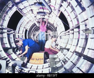Women workers install fixtures and assemblies to a tail fuselage section of a B-17F bomber at the Douglas Aircraft Company, Long Beach, .jpg - RB15FT  - Stock Photo