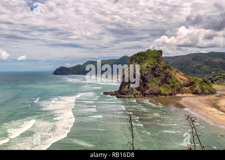 Lion rock at Piha beach, western coast of Auckland, New Zealand - Stock Photo