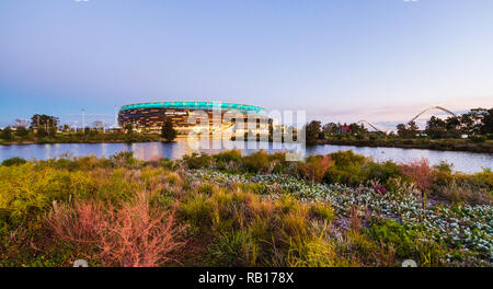 Optus Stadium surrounded by a lake and parkland. - Stock Photo