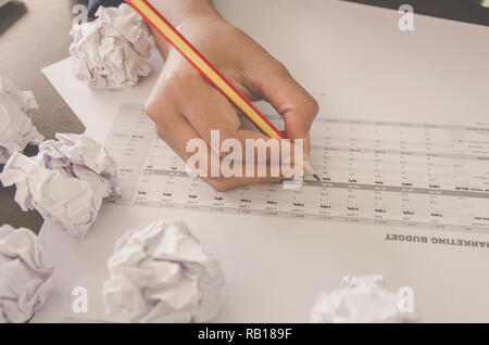 No idea and fail concept - Businesswoman sitting with crumpled paper or trash and paper ball or waste on the floor, Businessman are crumpling a paper  - Stock Photo
