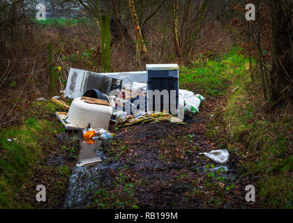 Fly tipping rubbish in the Cheshire countryside - Stock Photo