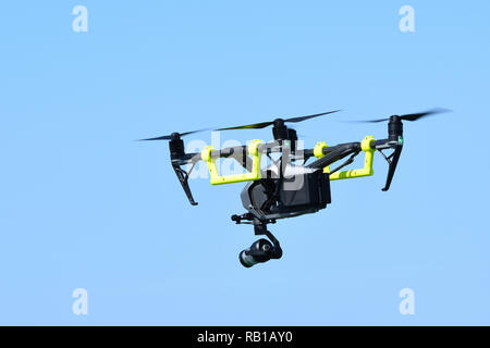 DJI Inspire 2 Quadcopter, a drone fitted with video camera in the sky. - Stock Photo