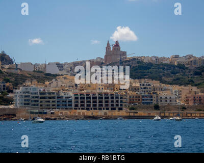 The Parish Church of Mellieha on top of the hill overlooking the town in Malta - Stock Photo
